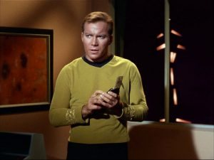 captain-kirk-using-communicator-startrek
